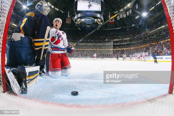 Ryan Callahan of the New York Rangers falls to his knees while celebrating his second period goal against Jhonas Enroth of the Buffalo Sabres at...