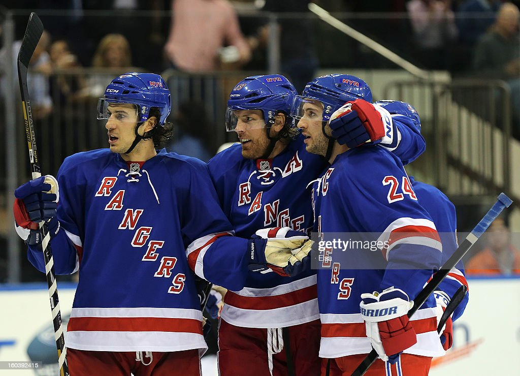 Ryan Callahan #24 of the New York Rangers is congratulated by teammates Michael Del Zotto #4 and Brad Richards #19 after Callahan scored a goal against the Philadelphia Flyers on January 29, 2013 at Madison Square Garden in New York City.