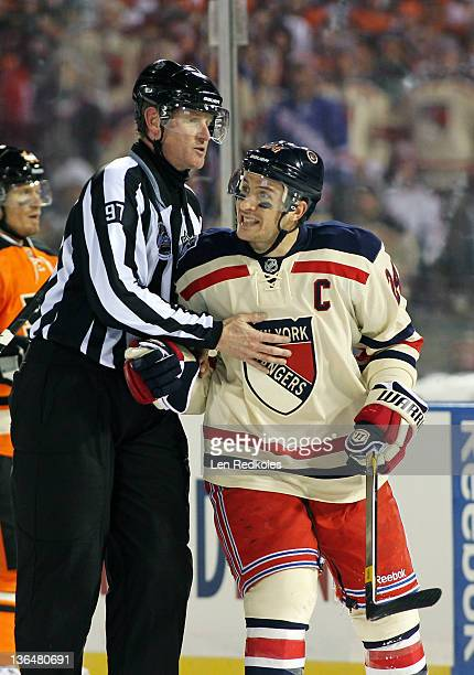 Ryan Callahan of the New York Rangers is restrained by Linesmen Jean Morin as he argues a call with Referee Ian Walsh against the Philadelphia Flyers...