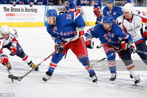 Ryan Callahan of the New York Rangers passes the puck against Sergei Fedorov of the Washington Capitals during Game Three of the Eastern Conference...