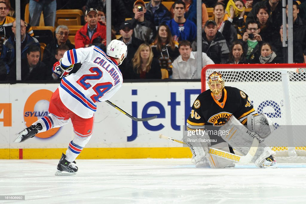 Ryan Callahan #24 of the New York Rangers shoots the puck against Tuukka Rask #40 of the Boston Bruins at the TD Garden on February 12, 2013 in Boston, Massachusetts.