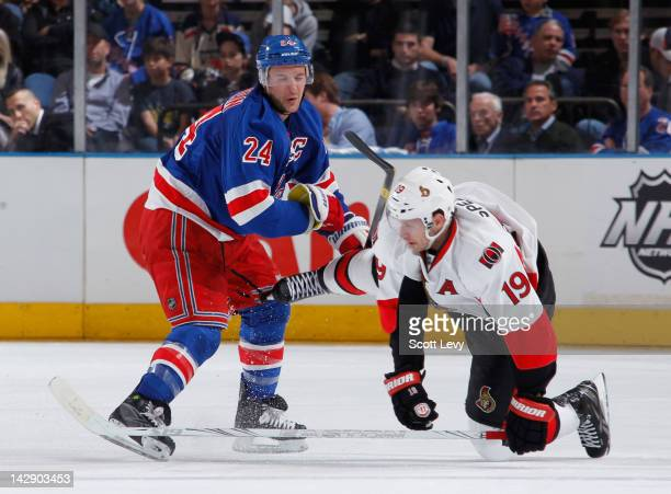 Ryan Callahan of the New York Rangers takes a skate to the knee by Jason Spezza of the Ottawa Senators in Game Two of the Eastern Conference...