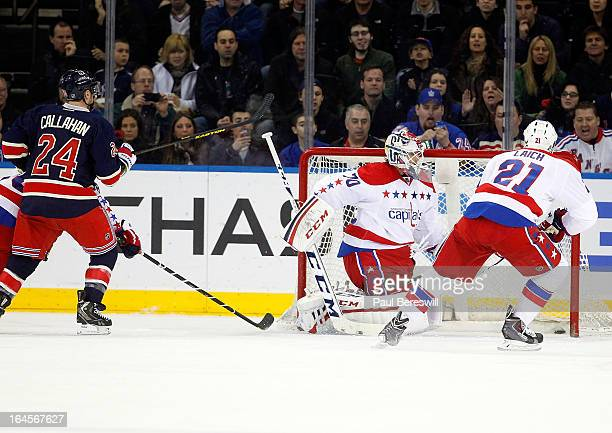 Ryan Callahan of the New York Rangers watches his shot in the first period go by goalie Braden Holtby for a goal in the first period of the...