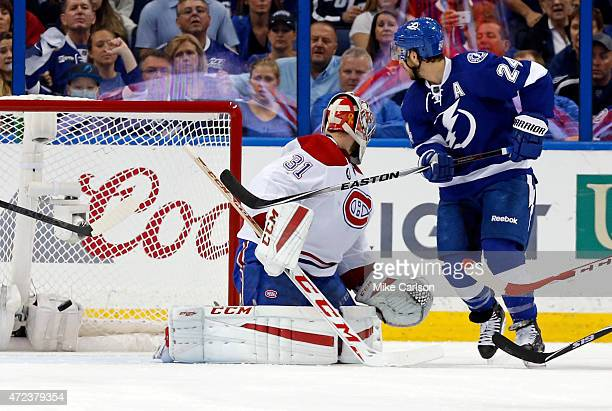 Ryan Callahan of the Tampa Bay Lightning and Carey Price of the Montreal Canadiens look at the puck going in for a goal in Game Three of the Eastern...