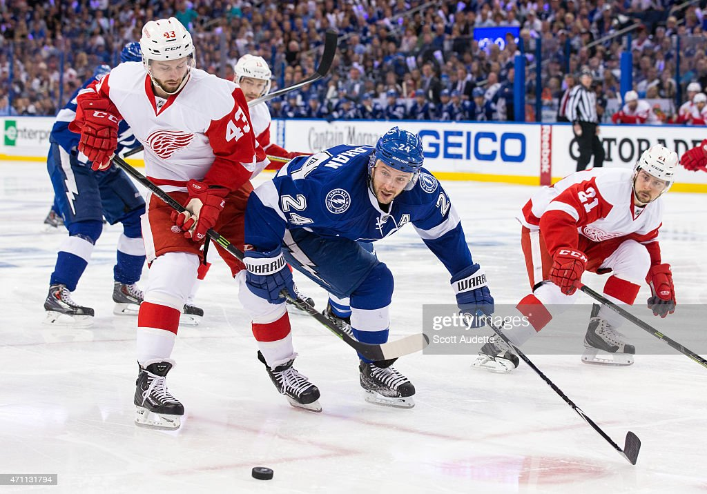Ryan Callahan #24 of the Tampa Bay Lightning battles for the puck against Darren Helm #43 of the Detroit Red Wings during the first period of Game Five of the Eastern Conference Quarterfinals during the 2015 NHL Stanley Cup Playoffs at the Amalie Arena on April 25, 2015 in Tampa, Florida.