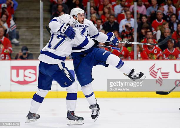 Ryan Callahan of the Tampa Bay Lightning celebrates his goal against the Chicago Blackhawks with teammate Alex Killorn during the first period of...