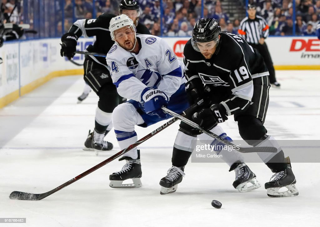 Ryan Callahan #24 of the Tampa Bay Lightning checks Alex Iafallo #19 of the Los Angeles Kings at the Amalie Arena on February 10, 2018 in Tampa, Florida.