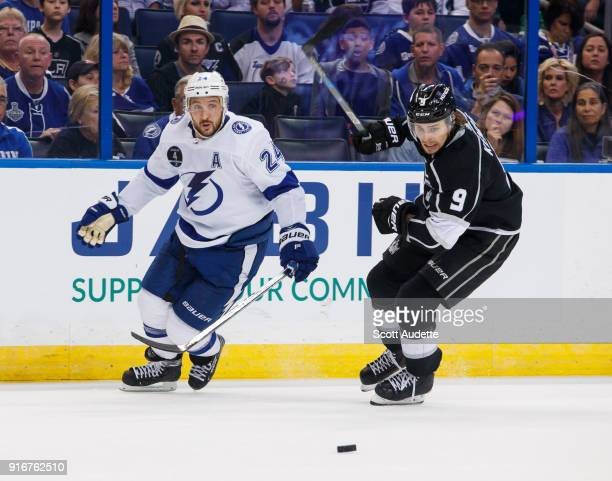 Ryan Callahan of the Tampa Bay Lightning skates against Adrian Kempe of the Los Angeles Kings during the third period at Amalie Arena on February 10...