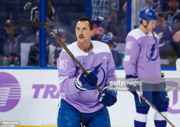 Ryan Callahan of the Tampa Bay Lightning wears lavender for Hockey Fights Cancer night against the New York Rangers during the pregame warm ups at...