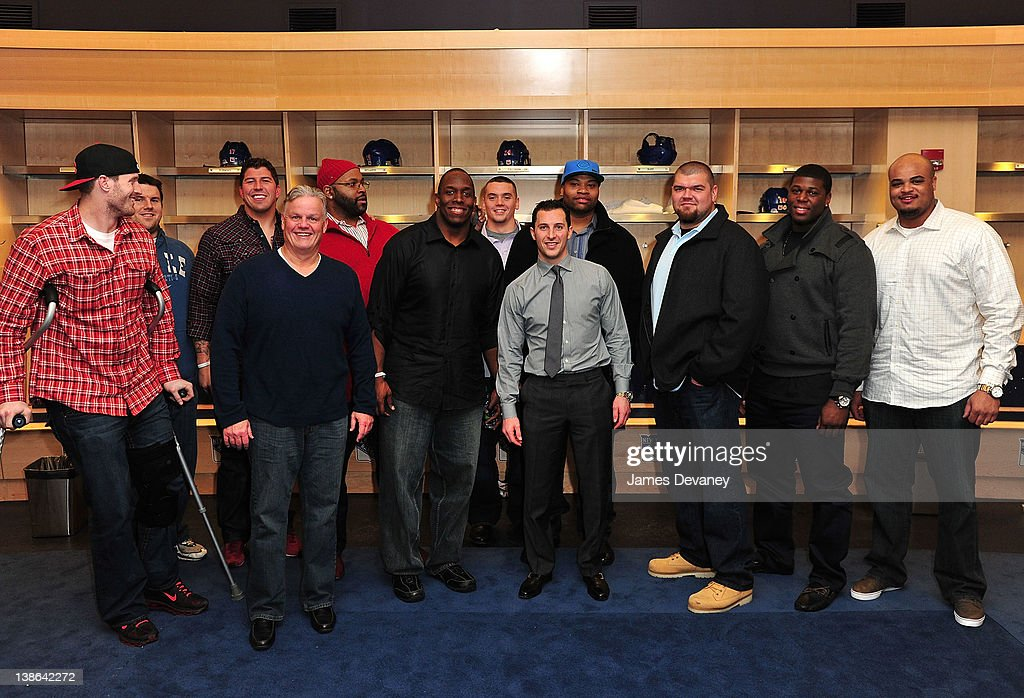 Ryan Callahan poses with New York Giants players in the Rangers locker room after the Tampa Bay Lightning vs the New York Rangers game at Madison Square Garden on February 9, 2012 in New York City.