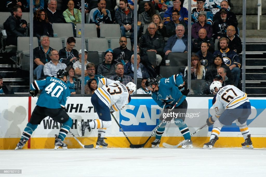 Ryan Carpenter #40 and Tim Heed #72 of the San Jose Sharks along with Sam Reinhart #23 and Benoit Pouliot #67 of the Buffalo Sabres battle along the boards at SAP Center at San Jose on October 12, 2017 in San Jose, California.