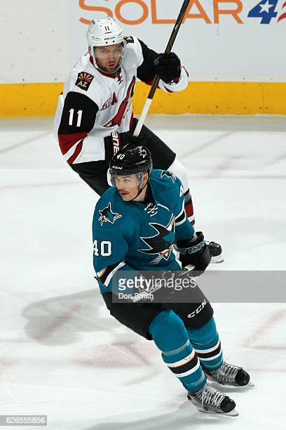 Ryan Carpenter of the San Jose Sharks skates against Martin Hanzal of the Arizona Coyotes during a NHL game at SAP Center at San Jose on November 29,...