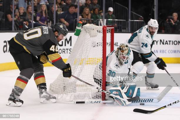 Ryan Carpenter of the Vegas Golden Knights attempts a wraparound shot on goaltender Aaron Dell of the San Jose Sharks in the second period Game One...