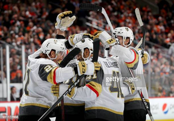 Ryan Carpenter of the Vegas Golden Knights is congratulated by teammates Cody Eakin and PierreEdouard Bellemare of the Vegas Golden Knights after he...