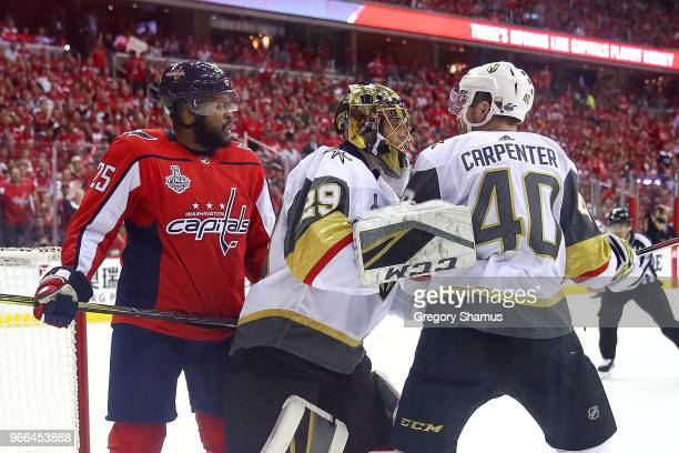 Ryan Carpenter of the Vegas Golden Knights is separated by MarcAndre Fleury after exchanging words with Devante SmithPelly of the Washington Capitals...