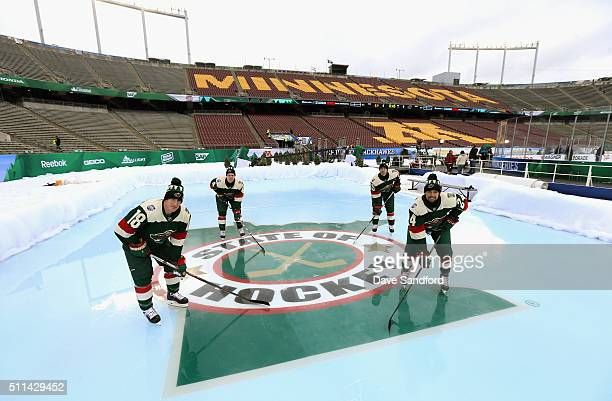 Ryan Carter Mike Reilly Nate Prosser and Matt Dumba of the Minnesota Wild stand in position at an auxiliary rink during practice for the 2016 Coors...