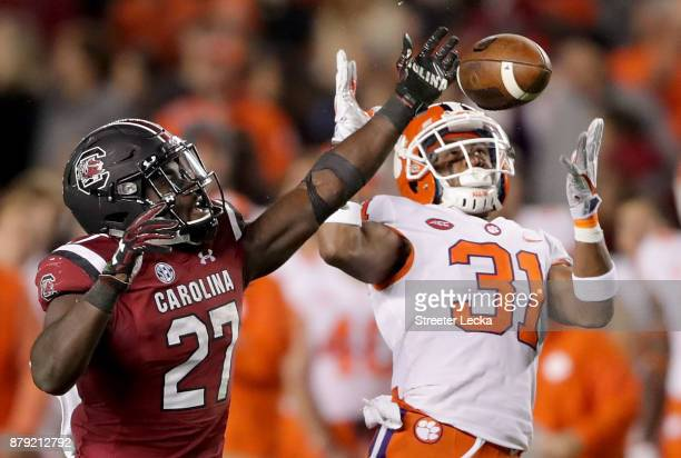 Ryan Carter of the Clemson Tigers tries to break up a pass to Ty'Son Williams of the South Carolina Gamecocks during their game at WilliamsBrice...