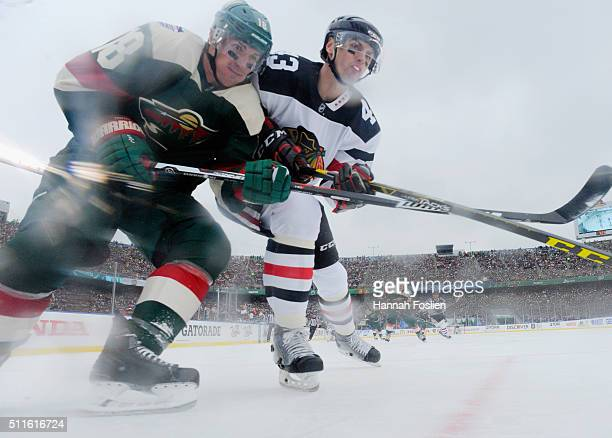 Ryan Carter of the Minnesota Wild skates against Viktor Svedberg of the Chicago Blackhawks during the first period at the TCF Bank Stadium during the...