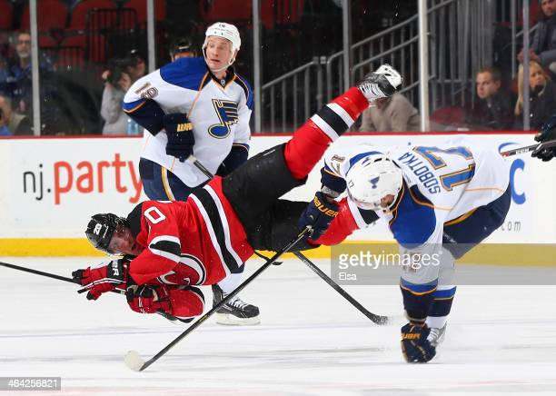 Ryan Carter of the New Jersey Devils is hit by Vladimir Sobotka of the St Louis Blues in the first period at Prudential Center on January 21 2014 in...