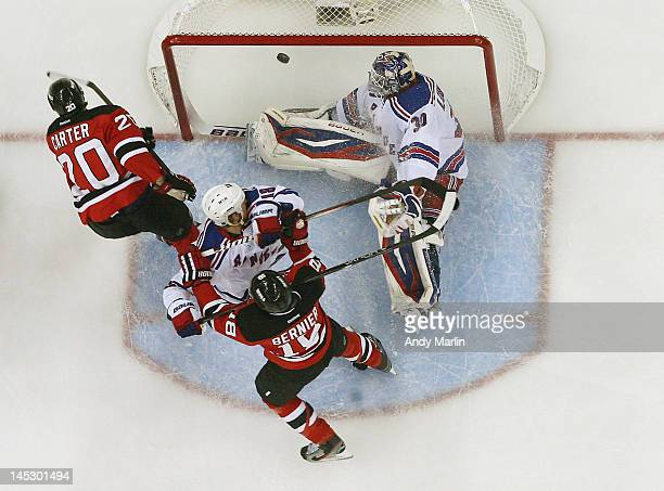 Ryan Carter of the New Jersey Devils puts the puck past Henrik Lundqvist of the New York Rangers for a goal in Game Six of the Eastern Conference...