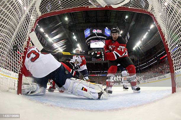 Ryan Carter of the New Jersey Devils scores a potenial goal which would of tied the score 44 in the second period but the goal was over turned on...