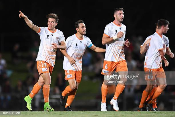 Alex Brosque of Sydney FC celerbtes with team mates after scoring a goal during the FFA Cup round of 16 match between Cairns FC and Sydney FC at...
