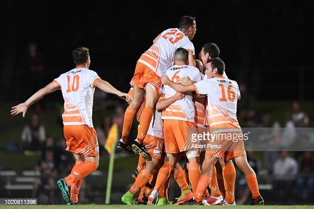 Ryan Cavanah of Cairns FC celebrates with team mates after scoring a goal during the FFA Cup round of 16 match between Cairns FC and Sydney FC at...