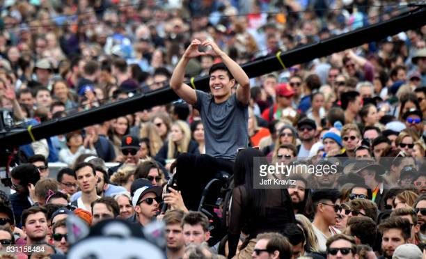 Ryan Chen crowdsurfs while Young the Giant performs on the Lands End stage during the 2017 Outside Lands Music And Arts Festival at Golden Gate Park...