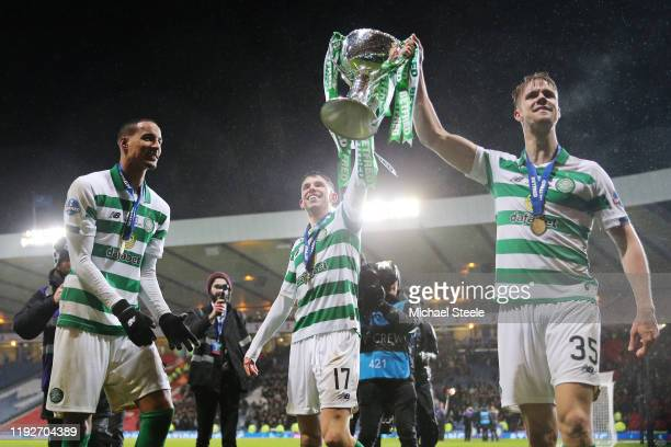 Ryan Christie and Kristoffer Ajer of Celtic lift the trophy following victory in the Betfred Cup Final between Rangers FC and Celtic FC at Hampden...