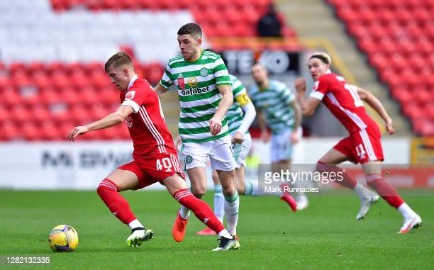 Ryan Christie of Celtic and Ross McCrorie of Aberdeen battle for the ball during the Ladbrokes Scottish Premiership match between Aberdeen and Celtic...