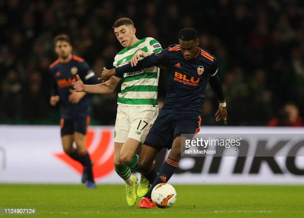 Ryan Christie of Celtic battles for possession with Geoffrey Kondogbia of Valencia during the UEFA Europa League Round of 32 First Leg match between...