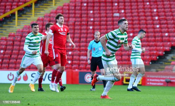 Ryan Christie of Celtic celebrates scoring his team's third goal from a penalty during the Ladbrokes Scottish Premiership match between Aberdeen and...