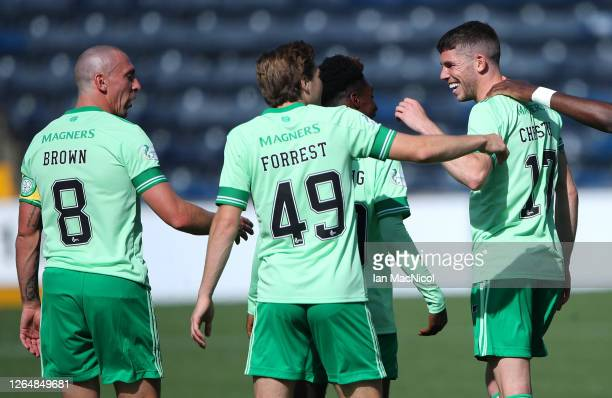 Ryan Christie of Celtic celebrates with James Forrest and Scott Brown after scoring his team's first goal during the Ladbrokes Scottish Premiership...