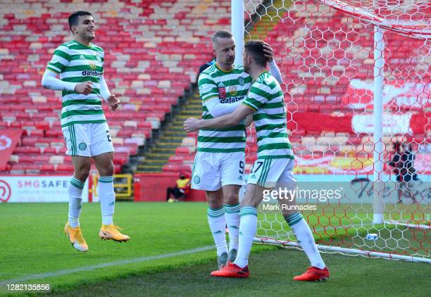 Ryan Christie of Celtic celebrates with teammate Leigh Griffiths after scoring his team's third goal from a penalty during the Ladbrokes Scottish...