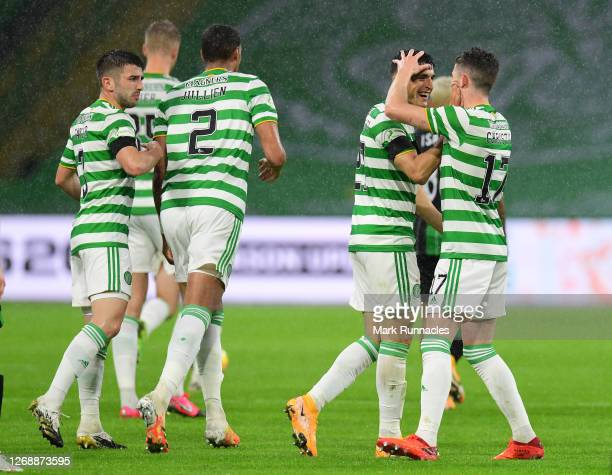 Ryan Christie of Celtic celebrates with teammate Mohamed Elyounoussi of Celtic after scoring his team's first goal during the UEFA Champions League:...