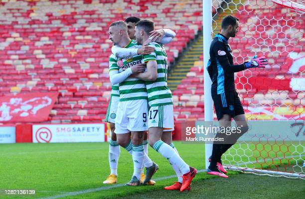 Ryan Christie of Celtic celebrates with teammates after scoring his team's third goal from a penalty during the Ladbrokes Scottish Premiership match...