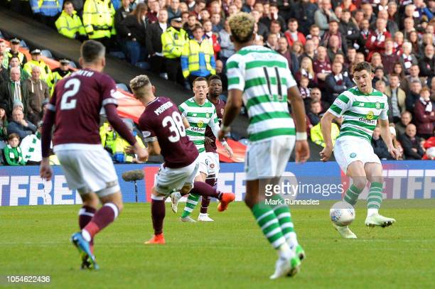 Ryan Christie of Celtic scores his team's third goal during the Betfred Scottish League Cup Semi Final between Heart of Midlothian FC and Celtic FC...