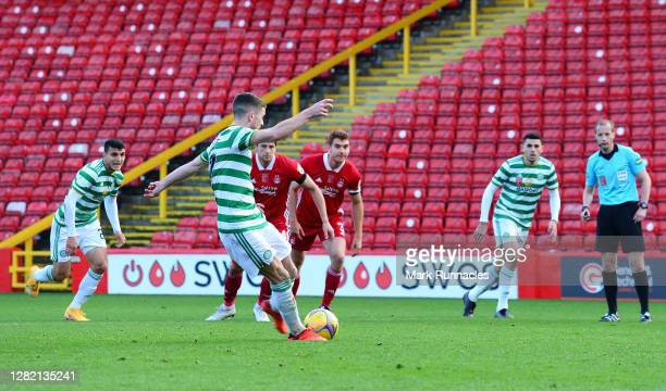 Ryan Christie of Celtic scores his team's third goal from a penalty during the Ladbrokes Scottish Premiership match between Aberdeen and Celtic at...