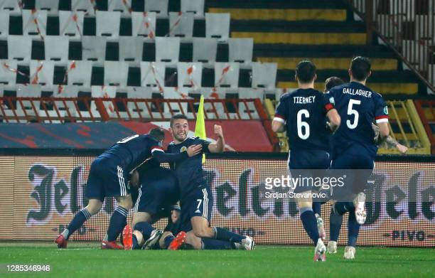 Ryan Christie of Scotland celebrates after scoring his team's first goal with his team during the UEFA EURO 2020 Play-Off Final between Serbia and...