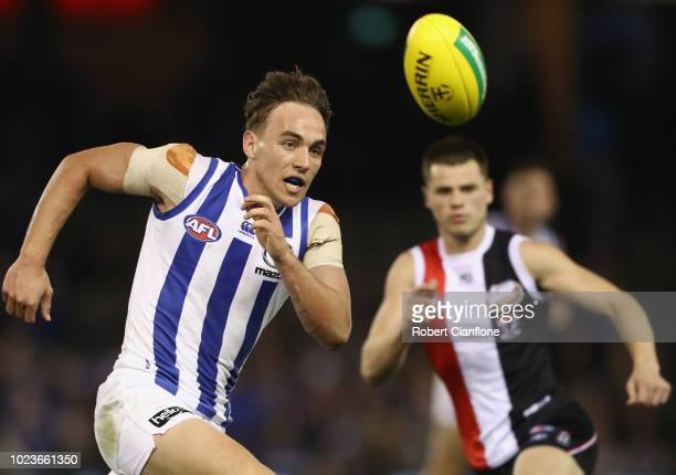 Ryan Clarke of the Kangaroos handballs during the round 23 AFL match between the St Kilda Saints and the North Melbourne Kangaroos at Etihad Stadium...