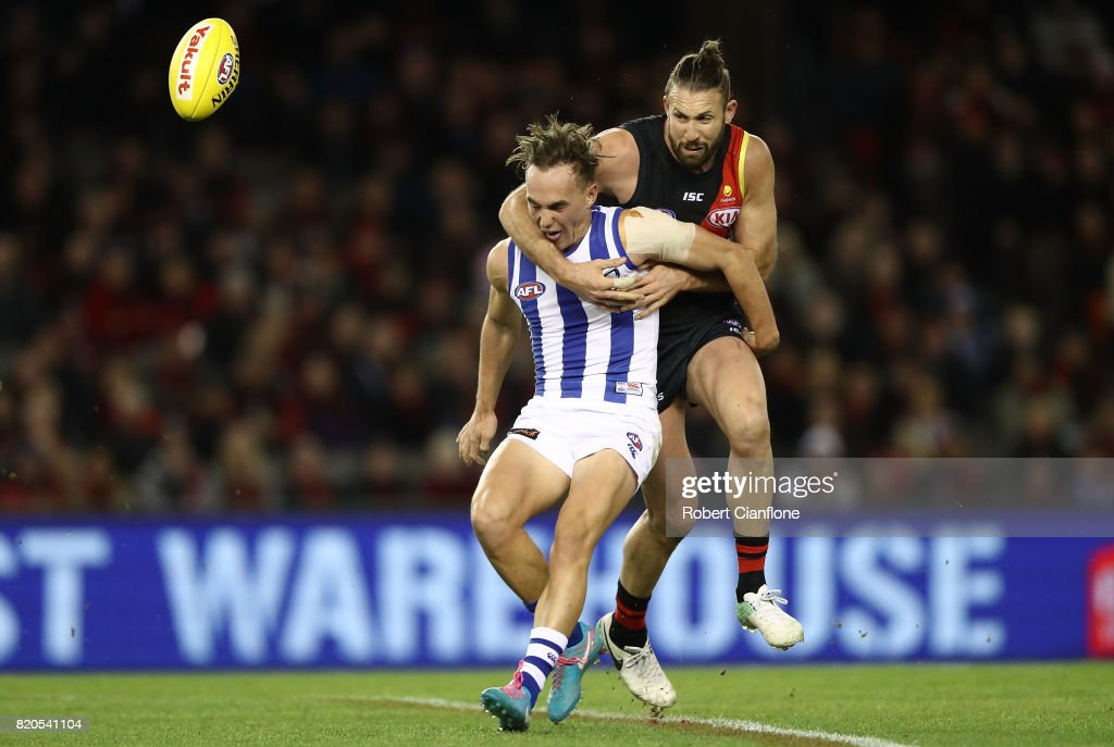 Ryan Clarke of the Kangaroos is challenged by Cale Hooker of the Bombers during the round 18 AFL match between the Essendon Bombers and the North Melbourne Kangaroos at Etihad Stadium on July 22, 2017 in Melbourne, Australia.