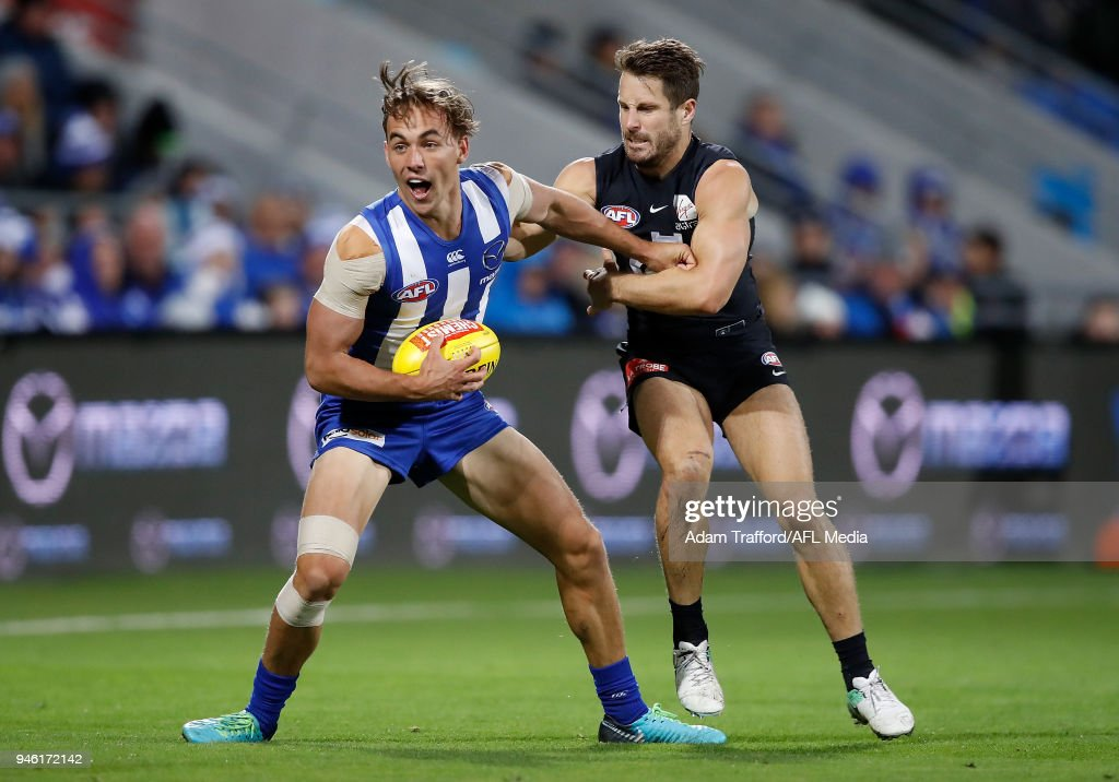 Ryan Clarke of the Kangaroos is tackled by Matthew Wright of the Blues during the 2018 AFL Round 04 match between the North Melbourne Kangaroos and the Carlton Blues at Blundstone Arena on April 14, 2018 in Hobart, Australia.