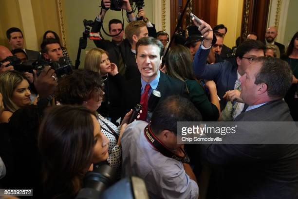 Ryan Clayton of Americans Take Action is corralled by police after he threw Russian flags at Senate Majority Leader Mitch McConnell and US President...