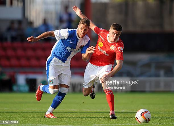 Ryan Colclough of Crewe Alexandra competes with Ruben Rochina of Blackburn Rovers during the pre season friendly match between Crewe Alexandra and...