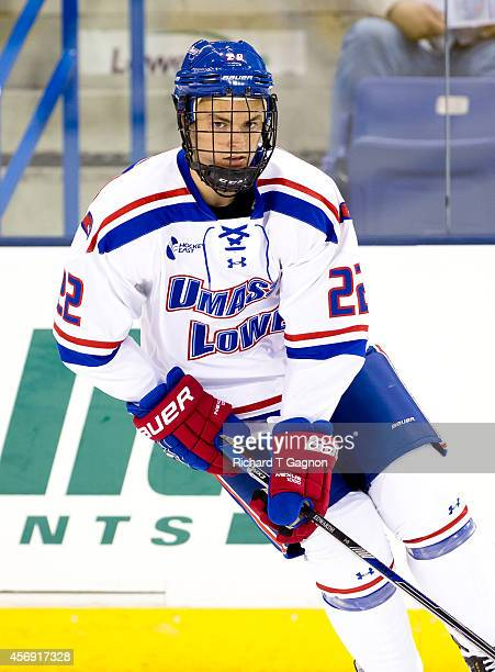 Ryan Collins of the Massachusetts Lowell River Hawks skates against the St. Thomas University Tommies during NCAA exhibition hockey at the Tsongas...