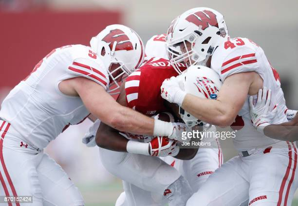 Ryan Connelly and Garret Dooley of the Wisconsin Badgers make a tackle against the Indiana Hoosiers in the first quarter of a game at Memorial...