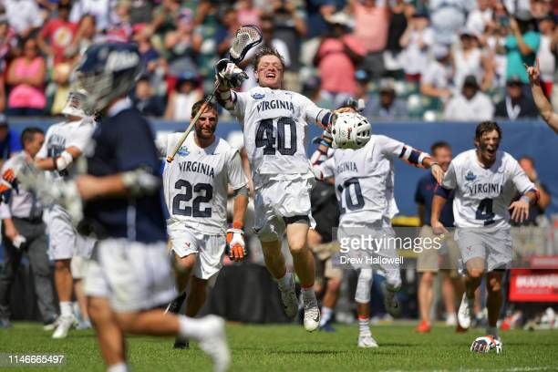 Ryan Conrad Ryan Lamb Xander Dickson and Jeff Conner of Virginia Cavaliers run onto the field after beating the Yale Bulldogs 139 for the NCAA...