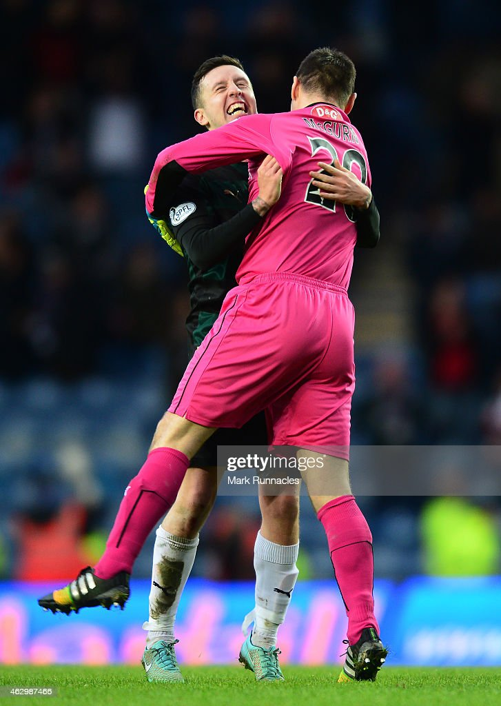 Ryan Conroy and goalkeeper David McGurn of Raith Rovers celebrate at the end of the match after beating Rangers 1-2 during the William Hill Scottish Cup Fifth Round match between Rangers and Raith Rovers on February 8, 2015 in Glasgow Scotland.
