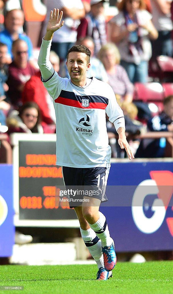 Ryan Conway of Dundee celebrates after scoring a penalty during the Clydesdale Bank Scottish Premier League match between Hearts and Dundee at Tyncastle Stadium on September 2, 2012 in Edinburgh, Scotland.