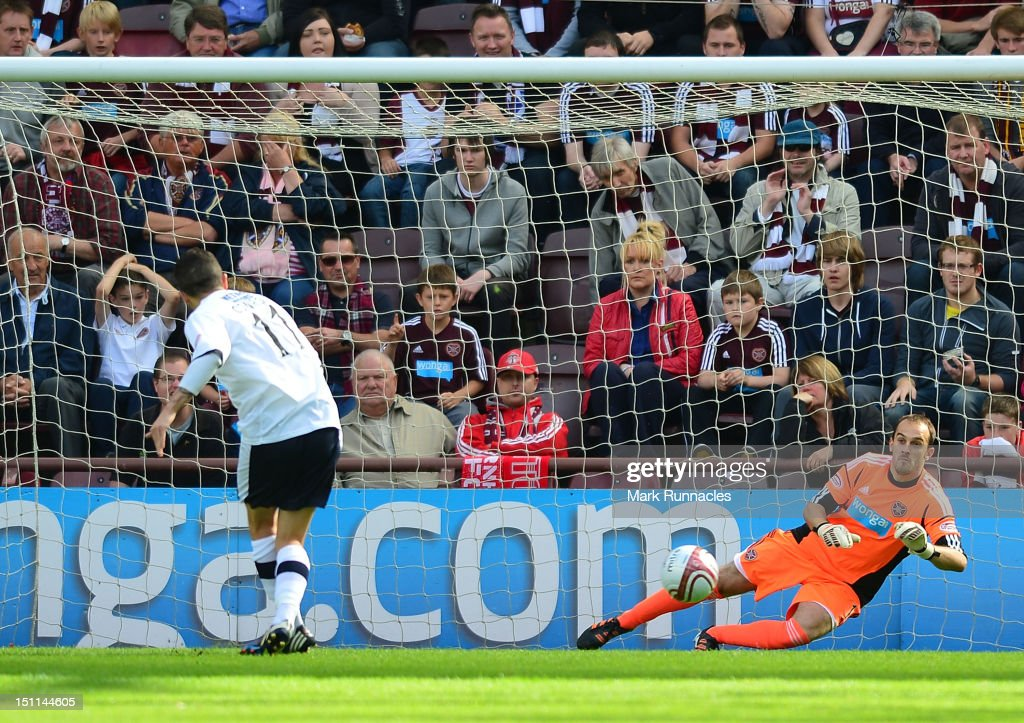 Ryan Conway of Dundee scores a penalty past Hearts goalkeeper Jamie MacDonald during the Clydesdale Bank Scottish Premier League match between Hearts and Dundee at Tyncastle Stadium on September 2, 2012 in Edinburgh, Scotland.